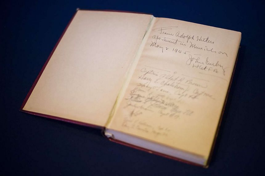 A copy of Nazi leader, Adolf Hitler's, political manifesto Mein Kampf, discovered at his Munich apartment and signed by eleven American officers, is on display on March 18, 2016 before auction at Alexander Historical Auctions in Chesapeake City, Mary