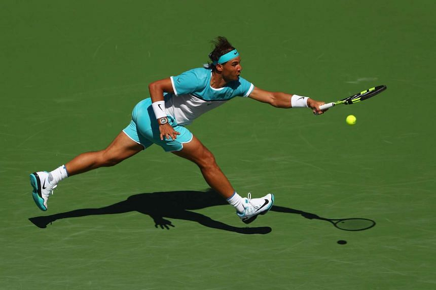 Rafael Nadal of Spain in action in his match against Kei Nishikori of Japan during day twelve of the BNP Paribas Open at Indian Wells Tennis Garden on March 18, 2016 in Indian Wells, California.