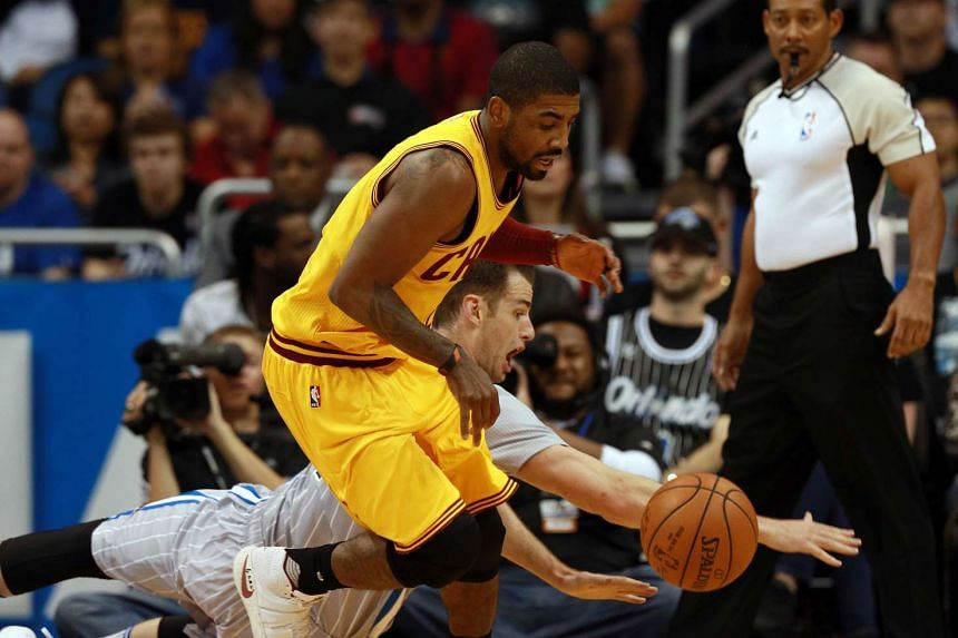 Kyrie Irving (front) and Jason Smith go after the rebound during the second quarter at Amway Center on March 19, 2016.