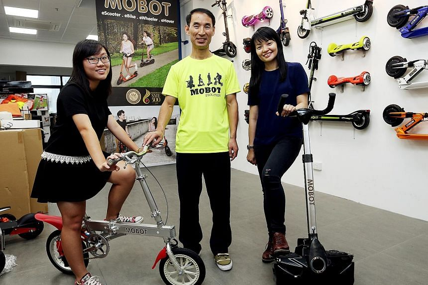 The latest winners of the ST Run giveaway - Ms Yolanda Constantine (right) and student Kuah Xiu Juan - with Mr Ifrey Lai, managing director of iZest, the distributor for Mobot. Ms Constantine and Xiu Juan won a Mobot glider and Mobot Kinetic eBike re