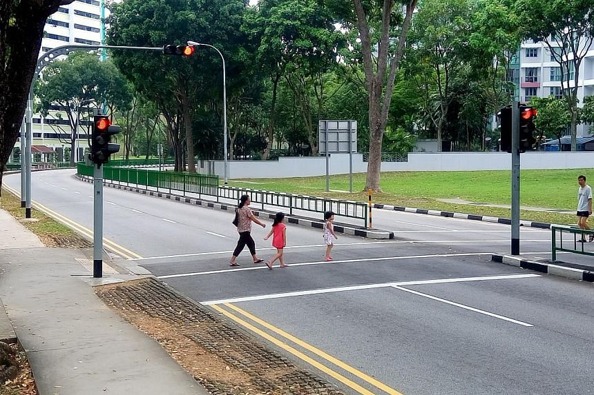 The lights were green in Mr Li's favour when he was knocked down by a cab driver in 2011 at the crossing in Bukit Batok West Avenue 5 (above). In 2014, the High Court found the driver fully to blame for the accident.