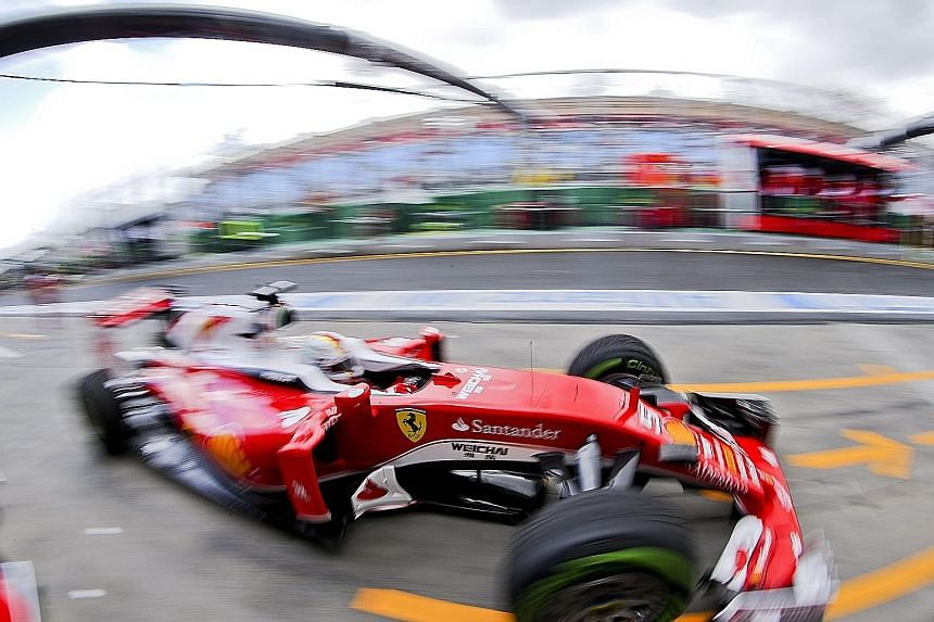 Sebastian Vettel of Ferrari in yesterday's first practice for the Australian Grand Prix. He did not post a time in gusty winds but was eighth quickest in the second session. Current world champion Lewis Hamilton topped both timesheets.