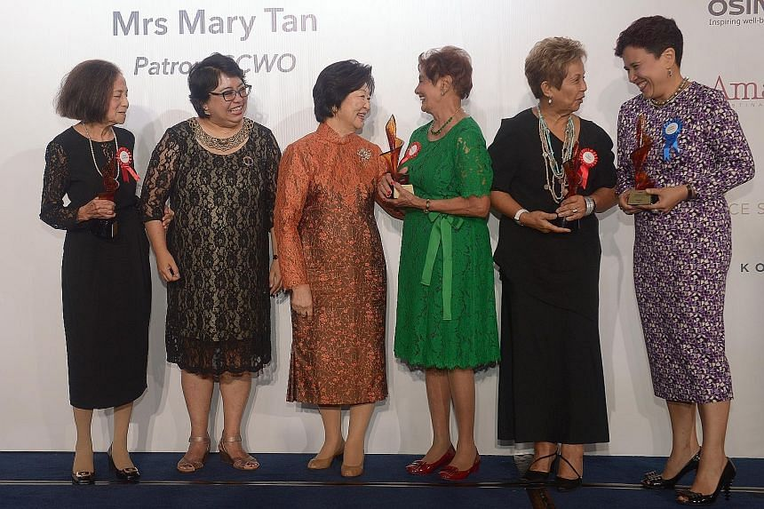 Fourteen women were inducted into the Singapore Women's Hall of Fame last night in recognition of their contributions to Singapore and beyond. Mrs Mary Tan (centre), wife of President Tony Tan Keng Yam and patron of the Singapore Council of Women's O