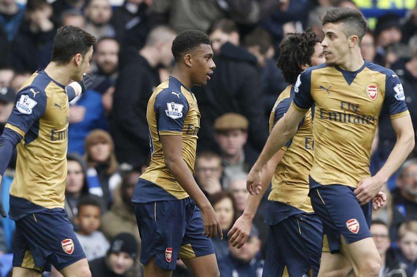 Arsenal's Alex Iwobi celebrates scoring their second goal.