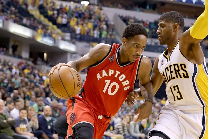 DeMar DeRozan (left) of the Toronto Raptors dribbling the ball against the Indiana Pacers on March 17.