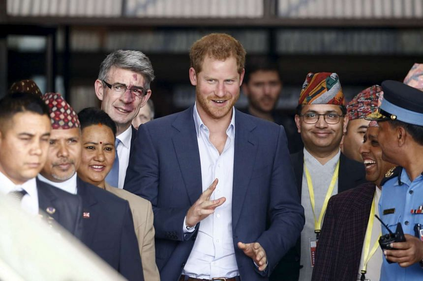Britain's Prince Harry walks out from the Tribhuvan International Airport upon his arrival in Kathmandu, Nepal, March 19, 2016.