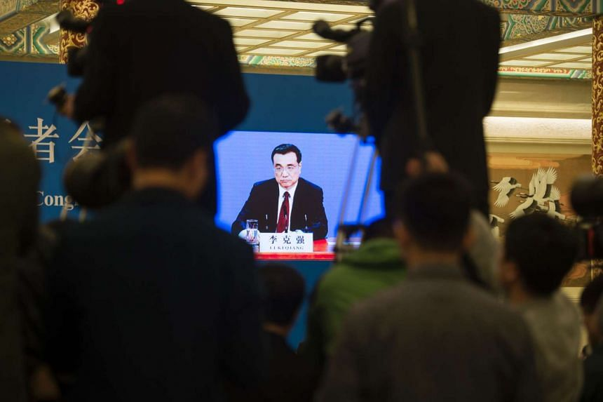 Chinese Premier Li Keqiang on screen during a press conference after the National People's Congress in Beijing on March 16.