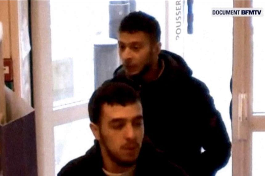 Abdeslam (rear) and suspected accomplice Hamza Attou are seen at a petrol station on a motorway between Paris and Brussels in November 2015.