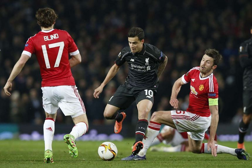 Philippe Coutinho, who scored a crucial away goal for Liverpool in the 1-1 Europa League last-16, second-leg draw, turning on the style against Manchester United's Daley Blind and Michael Carrick. United are sixth in the Premier League, two points be