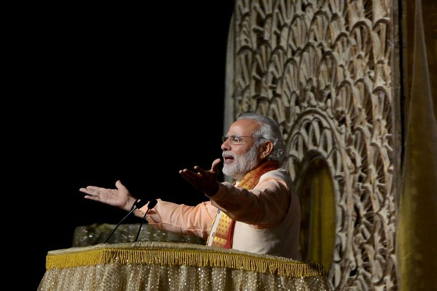 Mr Modi (above) praised spiritual guru Sri Sri Ravi Shankar at the World Culture Festival, highlighting the importance of India's holy men and their link to politics.