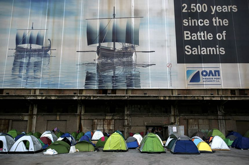 Migrants' tents at Piraeus port near Athens yesterday. Under the plan, the EU would take in one Syrian refugee from Turkish soil in exchange for every Syrian re-admitted to Turkey from Greece.