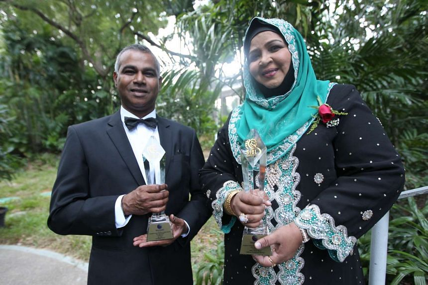 Mr Veera (left), founder of Greenology, and Ms Beevi (right) director of Saffrons Restaurant with their Singapore Indian Business Leaders Awards.