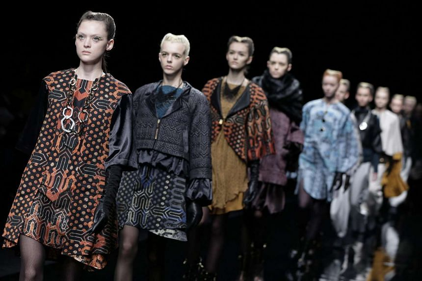 Models presenting creations by Japanese designer Yuma Koshino during the Mercedes-Benz Fashion Week in Tokyo on March 18.