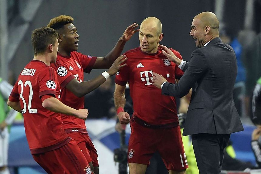 Bayern Munich's  Arjen Robben (second from right) celebrates with teammates and coach Pep Guardiola (right) after scoring a goal during their UEFA Champions League match against Juventus on Feb 23, 2016.