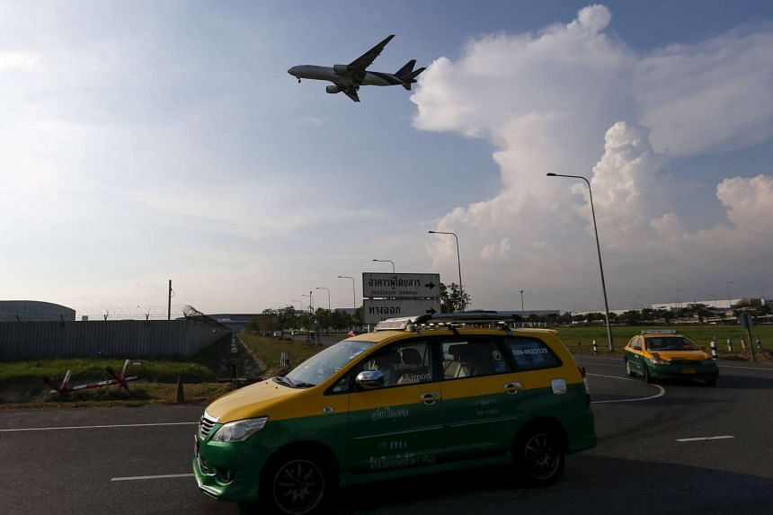 The passenger was detained for questioning at the airport, police said, and did not fly with the plane when it took off more than six hours behind schedule.