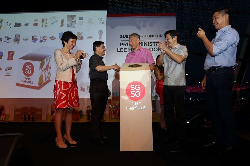 Prime Minister Lee Hsien Loong places the SG50 Jubilee Walk Marker as the final item in a symbolic sealing of the SG50 Time Capsule on March 18, 2016 at Gardens by the Bay.