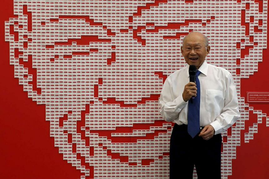 Dr Lee Suan Yew stands in front of the art installation made up of 4877 Singapore flag erasers featuring the portrait of his brother, the late Mr Lee Kuan Yew, on March 20, 2016.