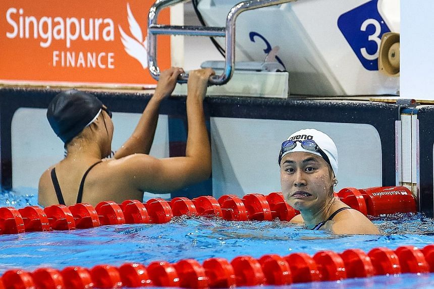 National swimmer Quah Ting Wen reacts in the pool after the 50m freestyle final during the Singapore National Age Group Swimming Championships yesterday. While the 23-year-old missed the Olympics 'A' qualifying mark of 25.28sec, her coach retains hop