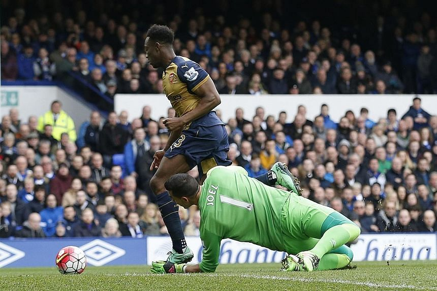 Danny Welbeck rounding Everton custodian Joel Robles to score Arsenal's opening goal in the 2-0 win, which revived their slim English Premier League chances. Manager Arsene Wenger was pleased with the team's response to their recent exits from the FA
