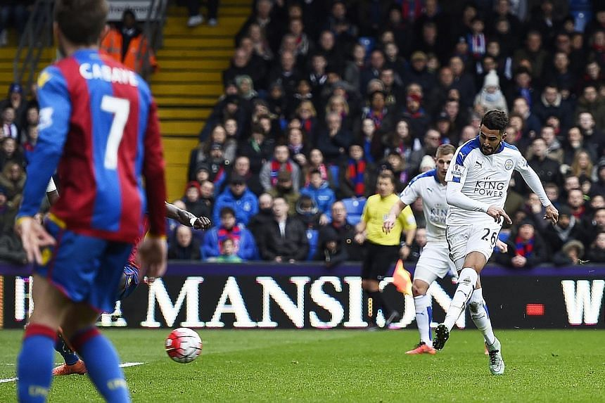 Leicester City winger Riyad Mahrez (right) sweeping home a superb pass from team-mate Jamie Vardy for his side's winner in their 1-0 victory over Crystal Palace at Selhurst Park yesterday. With the win, the Foxes opened up an eight-point gap between