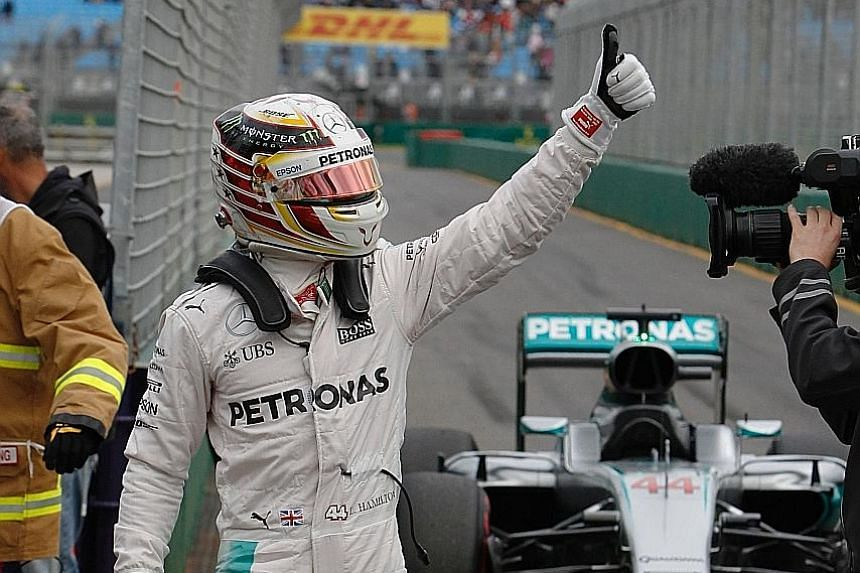 Mercedes driver Lewis Hamilton giving the fans a thumbs-up sign at Melbourne's Albert Park circuit after he qualified in pole position yesterday for the Australian Grand Prix. Toto Wolff, the head of Mercedes Motorsport, said the controversial qualif