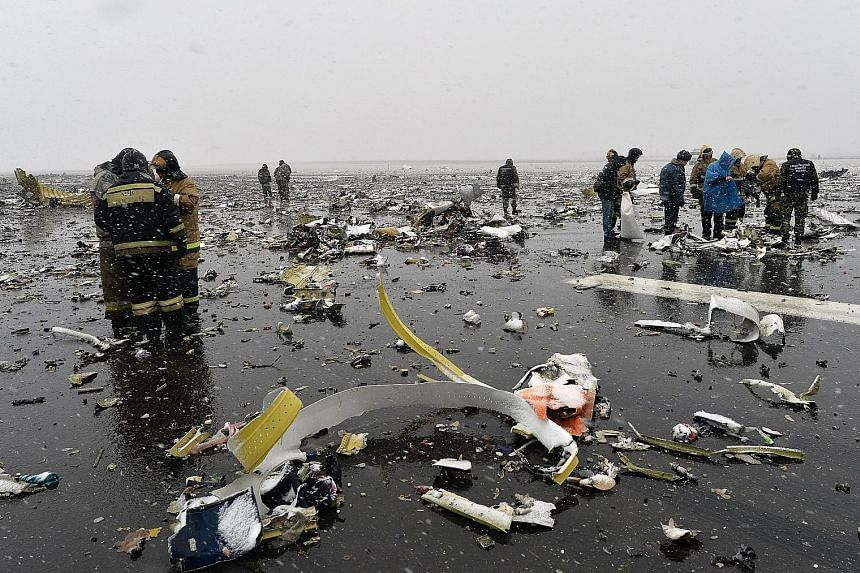 The Boeing 737 landed about 250m short of the start of the runway amid strong winds and heavy rain at Rostov-on-Don airport, erupting in a huge fireball as it crashed and scattering debris across a wide area. Investigators say the two black boxes hav