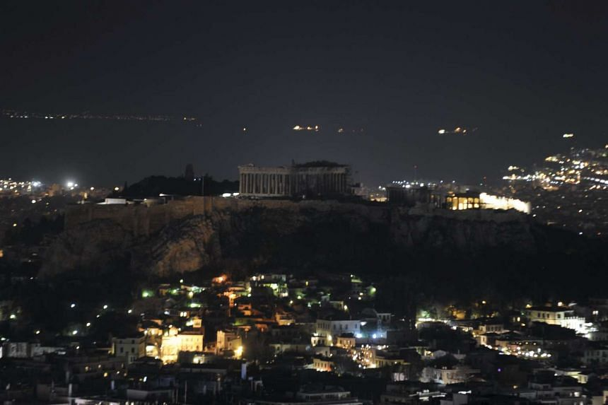 The hill of the Acropolis is pictured during Earth Hour in Athens, Greece.