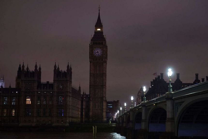 Britain's Houses of Parliament are submerged into darkness.
