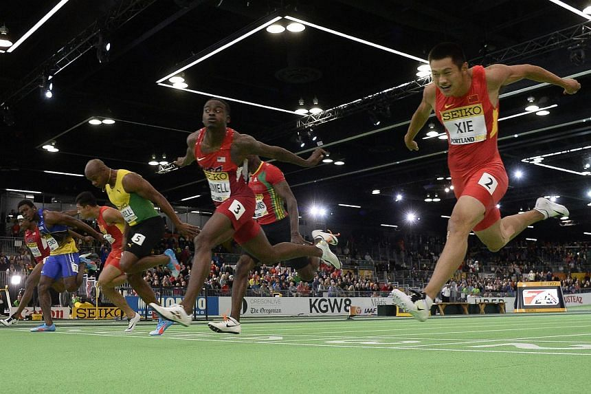 Trayvon Bromell of the USA (second right) comes in at first place, beating  Jamaica's Asafa Powell (fourth from left), during the men's 60 metres finals at the Iaaf World Indoor Championships.