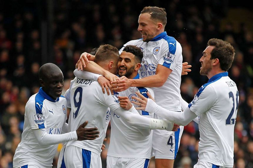 Leicester City's Riyad Mahrez (third right) celebrates after scoring his team's first goal.