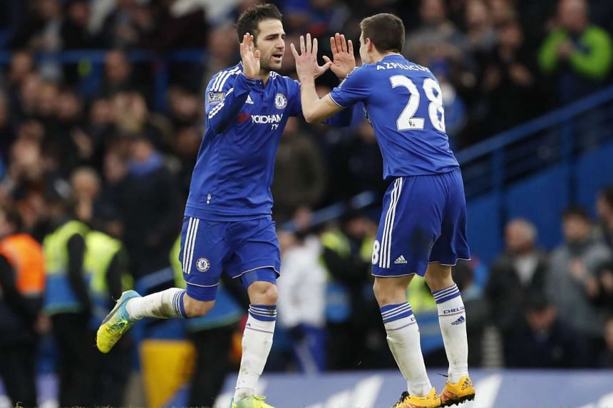 Cesc Fabregas celebrates with Cesar Azpilicueta after scoring the second goal for Chelsea from the penalty spot.
