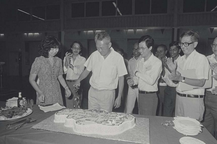 In 1980, Spottiswoode Park residents gave Mr Lee a cake for his 57th birthday. With him were (from right) Tiong Bahru MP Chng Jit Koon and Spottiswoode RC chairman Low Sze Hong.