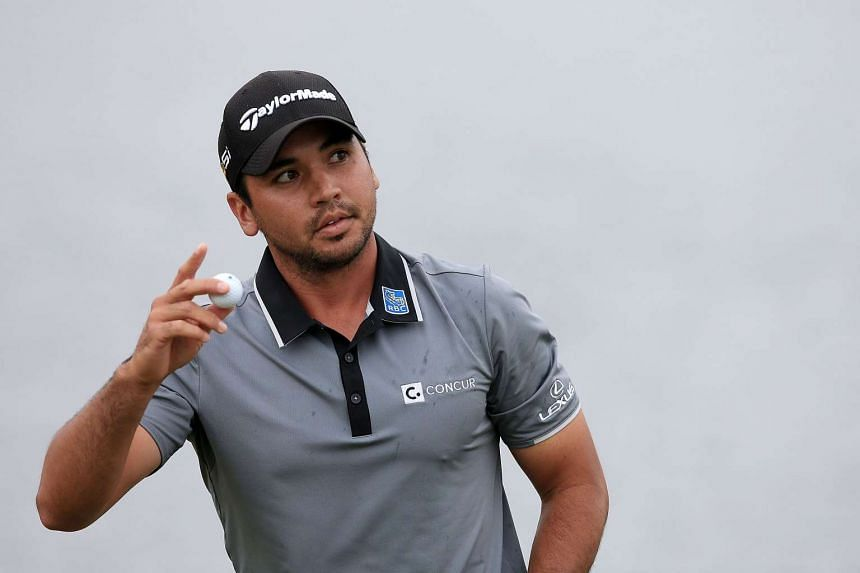 Jason Day of Australia waves to the crowd following the third round.