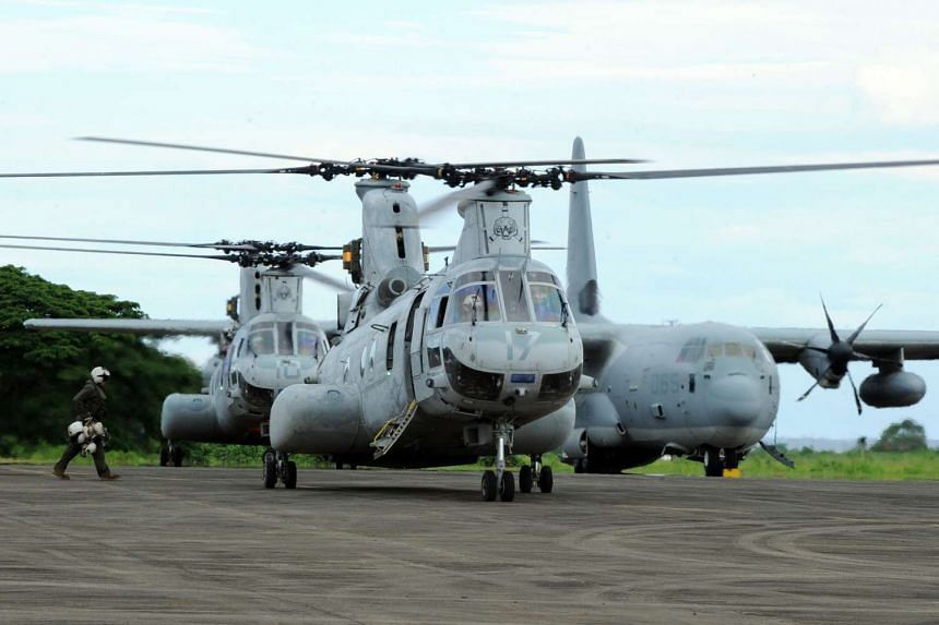 Two US CH-46 Sea Kinght helicopters taking off from a temporary US Marine base on Palawan island, south of Manila.