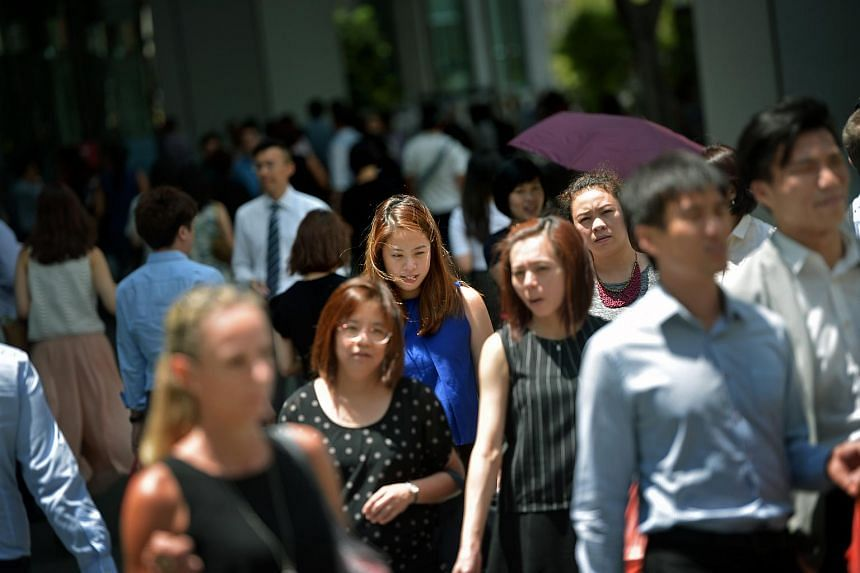 Office workers in the central business district at Raffles Place, on Feb 23, 2016.