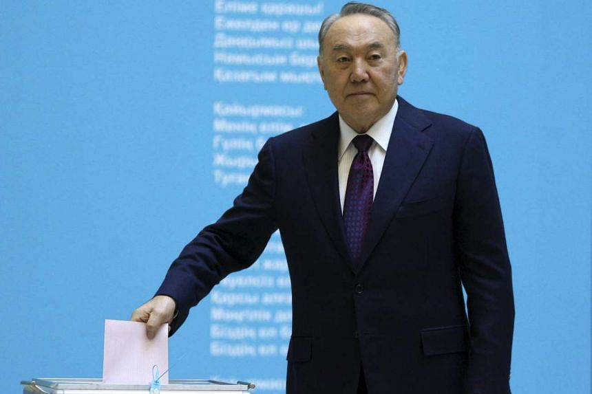 Kazakhstan's President Nursultan Nazarbayev casts his ballot at a polling station during a snap parliamentary election in Astana on March 20, 2016.
