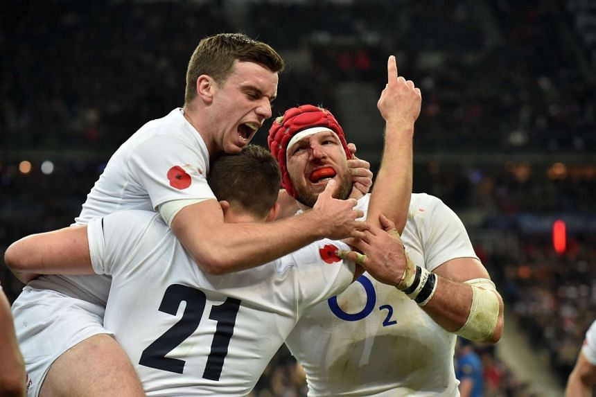 English players George Ford, Ben Youngs and James Haskell celebrate a try.