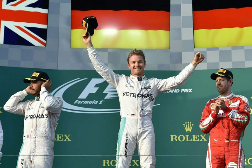 Nico Rosberg celebrates on the podium as teammate Lewis Hamilton (left) and Ferrari's Sebastian Vettel finished second and third respectively.