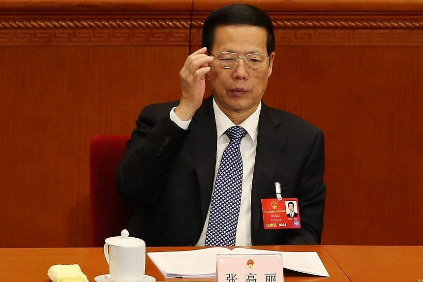 Chinese Vice Premier Zhang Gaoli adjust his glasses at the 12th National People's Congress in Beijing, on March 13, 2016.