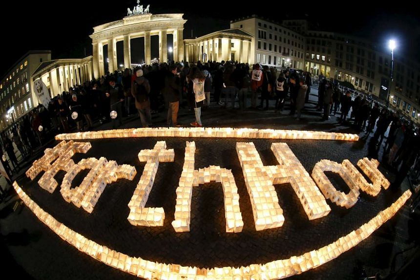 The Brandenburg Gate is seen before the Earth Hour in Berlin, Germany March 19, 2016.
