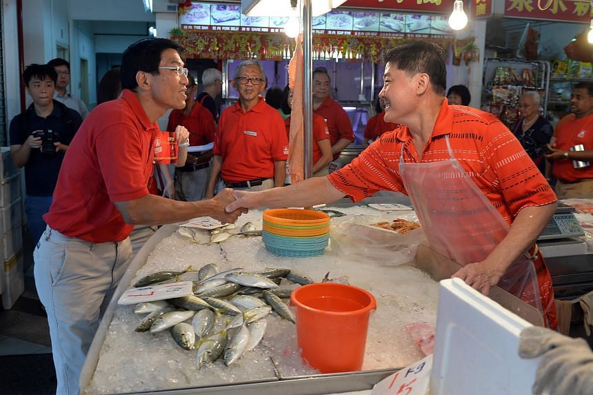 Dr Chee greeting Bukit Batok residents during the SDP's walkabout on March 20, 2016.