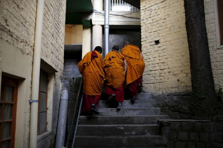 Tibetan monks arrive at Tsuglagkhang temple for prayer in Dharamsala, India, on March 19, 2016.