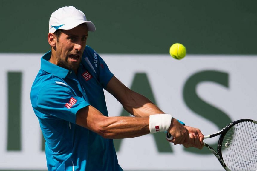 Novak Djokovic of Serbia returns the ball to Rafael Nadal in the men's semifinals, on March 19, 2016