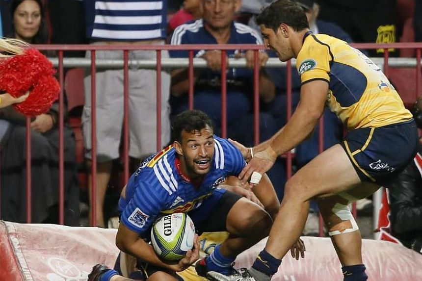 Dillyn Leyds (left) from the Stormers of South Africa reacts after scoring a try against the Brumbies of Australia.