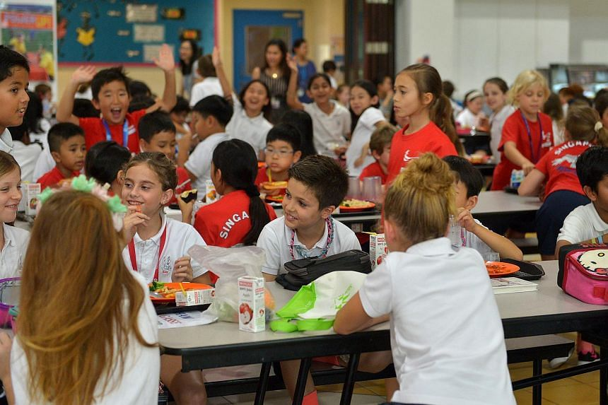 Students at the canteen in the Singapore American School.