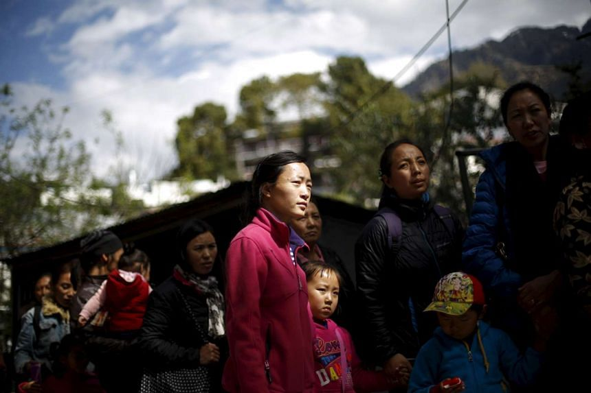 Tibetan in exile stand in a queue to cast their vote during the election for the Tibetan government-in-exile in Dharamsala, on March 20, 2016.