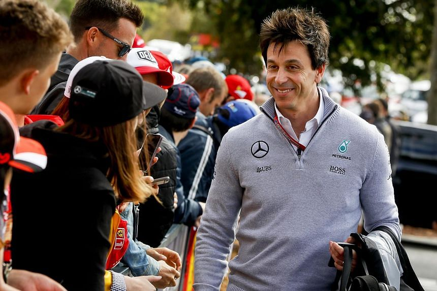 Mercedes motorsports boss Toto Wolff walks past Formula One fans at the Australian Formula One Grand Prix, on March 18, 2016.
