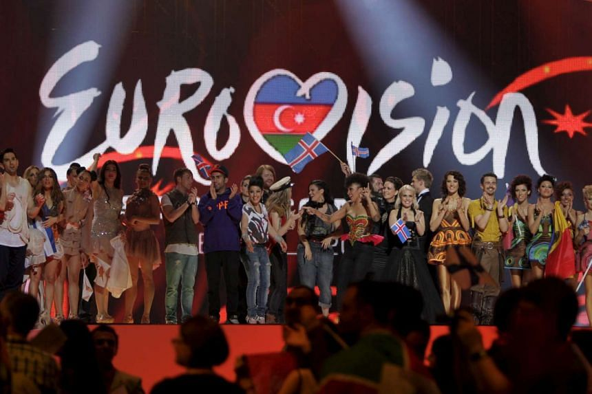 Winning contestants celebrate on stage after the first semi-final of the Eurovision song contest in Baku, Azerbaijan.