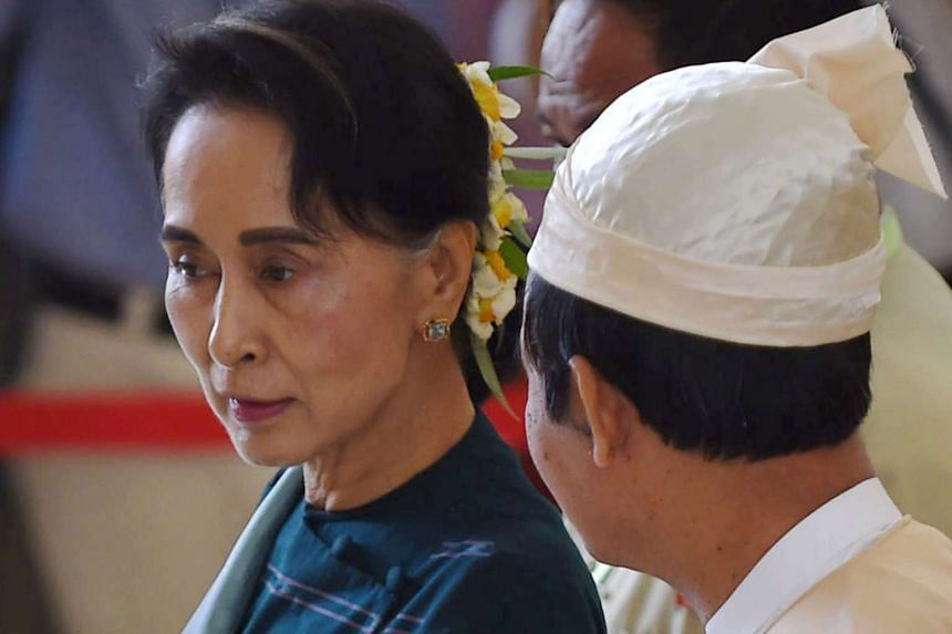 Myanmar democracy icon Aung San Suu Kyi (left) and Win Myint, lower house speaker from the National League for Democracy, leave parliament in Naypyidaw on March 15, 2016, after lawmakers elected Htin Kyaw, 69, to become the country's first civilian p
