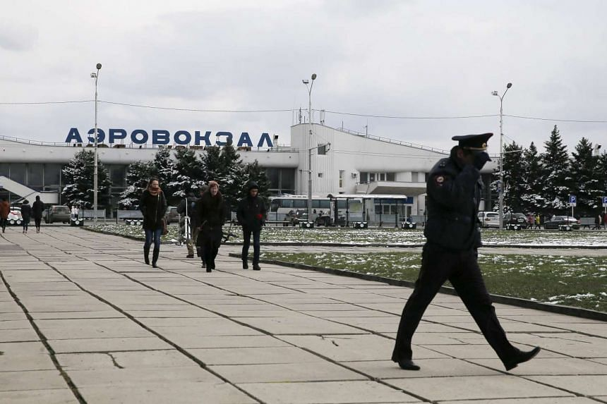 People walk near the airport of Rostov-On-Don in Russia on March 20, 2016.